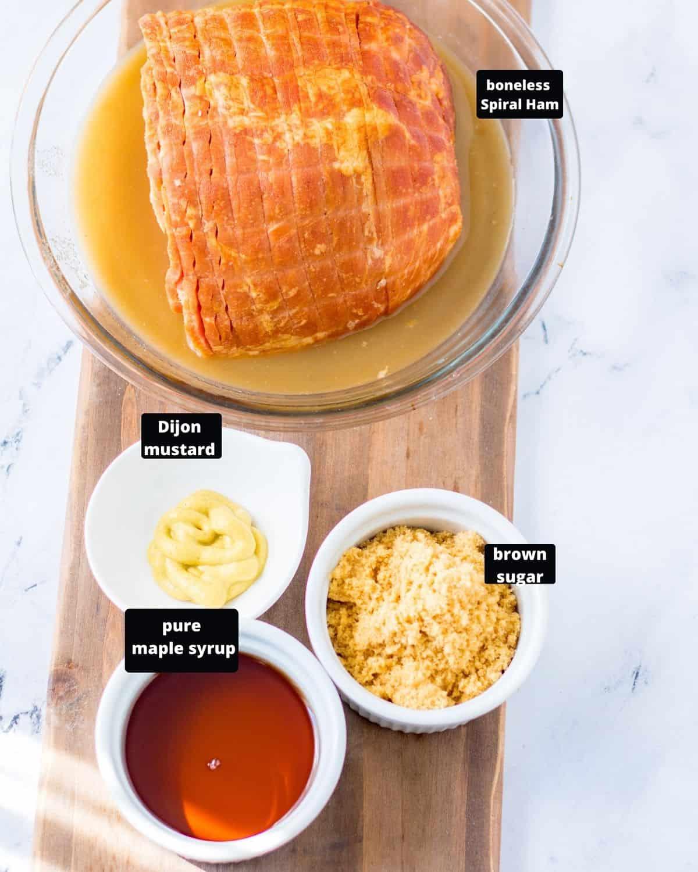 Maple glazed ham ingredients, boneless spiral ham, pure maple syrup, brown sugar, and dijon mustard.