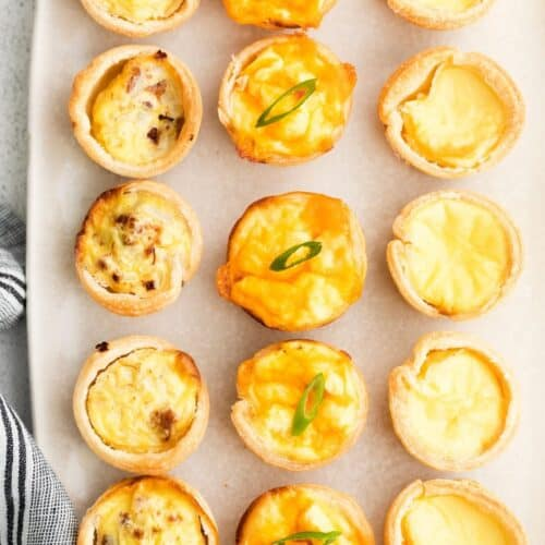 Mini quiches on a platter.