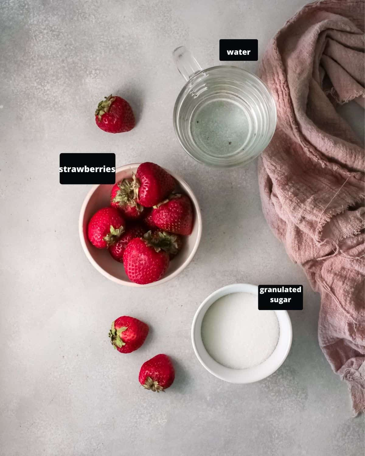 strawberries, sugar, and water- the ingredients to make sugar syrup.