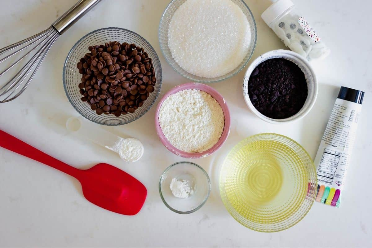 Ingredients to make brownies, chocolate chips, sugar, eggs, oil, baking soda, cornstarch