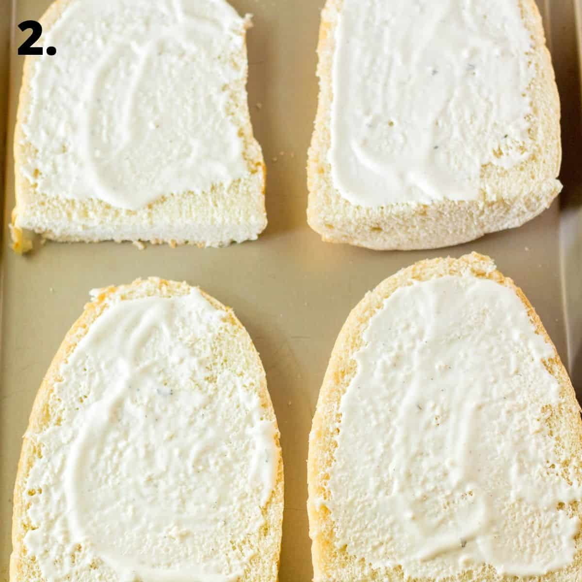 Four pieces of sliced french bread with ranch dressing on the bread.
