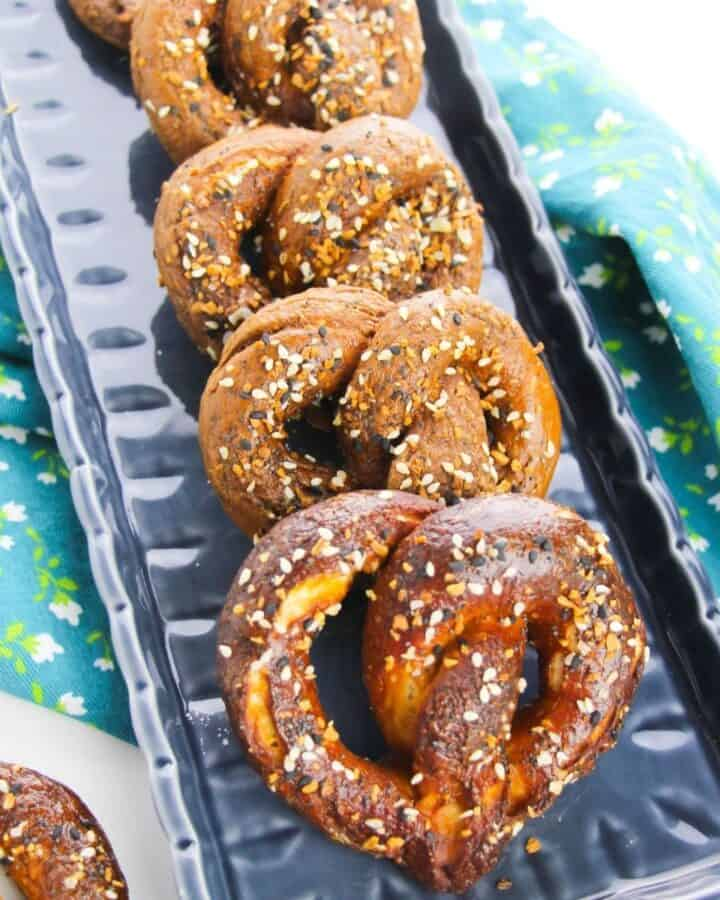 Hard pretzels on a blue ceramic tray.