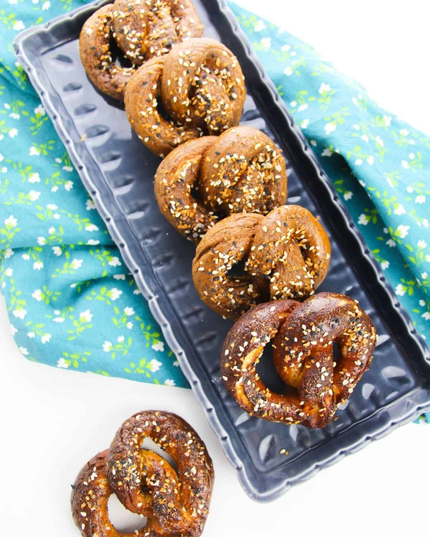 An overhead view of hard pretzels on a blue plate.