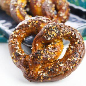 A hard pretzel with everything bagel seasoning on it.