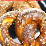 A golden brown pretzel cropped up on a plate.